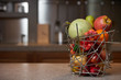 Fresh tropical fruits in abstract vase on kitchen counter table in luxury modern kitchen interior. Healthy vegetarian diet food and detox concept. Close-up, copy space - 199046220