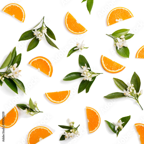 Orange fruit and flovers, above view.