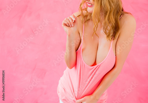 Woman with big cleavage posing in pink shirt