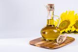 Sunflower seed oil in glass bottle on white background