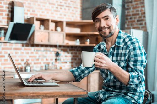 Positive happy man enjoying his tea
