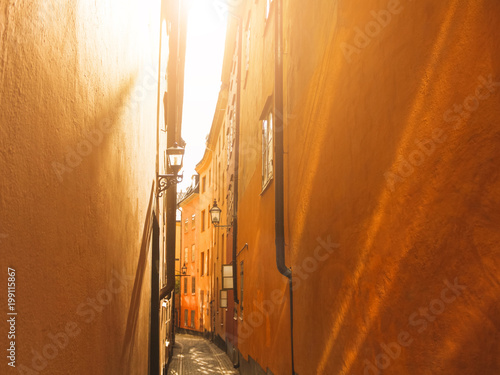 Fotobehang Stockholm Narrow street on sunny day. Old Town Center Stockholm