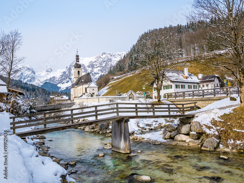 Fotobehang Blauwe hemel Panoramic view of scenic winter landscape in the Bavarian Alps with famous Parish Church of St. Sebastian in the village of Ramsau, Nationalpark Berchtesgaden Land, Bavaria, Germany