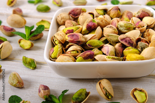 Mixed with peeled and unpeeled pitachio nuts close up