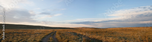 Poster Panoramafoto s Panorama Country Tyva steppe road. A wide view of the sky. Summer. Day
