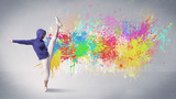 A funky contemporary hip hop dancer dancing in front of grey background with colorful bright paint splatter concept - 199130478