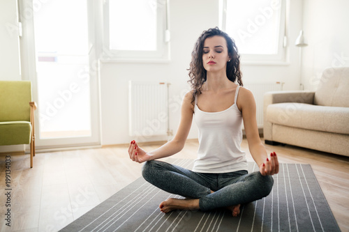 Foto op Aluminium School de yoga Young attractive woman relaxing and practicing yoga