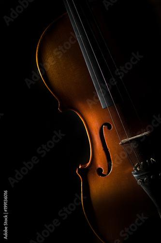 Violin on a black background in oblique light on one side - 199136016