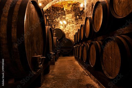 Wooden barrels with wine in a wine vault © Shchipkova Elena