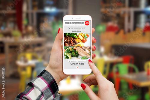 Foto Murales Girl ordering food with smartphone app in restaurant