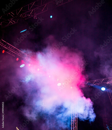 Color searchlight at a concert at night - 199141053