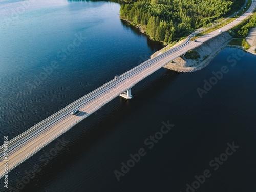 Fotobehang Bruggen Aerial view of bridge across blue lake in summer landscape in Finland