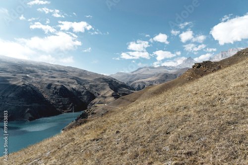 In de dag Blauwe jeans Landscape mountain lake. Natural high reservoir with epic rocks in the background. North Caucasus. Russia. Bylhum village