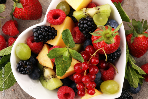 Foto Murales salad with fresh fruits and berries. healthy spring fruit salad