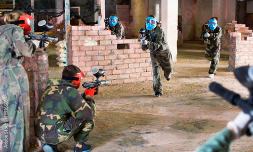 Teams faced on the battlefield in the arena of paintball.