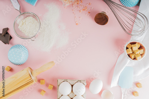 Frame of food ingredients for baking on a gently pink pastel background. Cooking flat lay with copy space. Top view. Baking concept. Mockup.