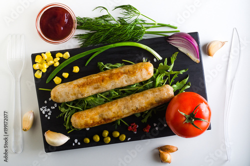 dish with sausages and vegetables, top view
