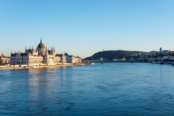 Budapest parliament and Chain Bridge and palace at the river Danube during sunset from the side