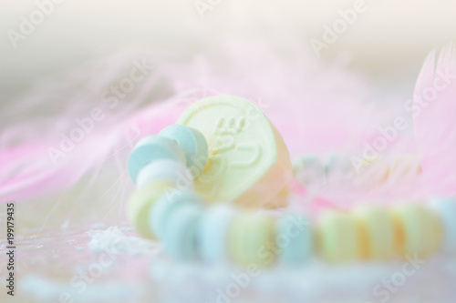 Heart  shape with love sign in pastel colors