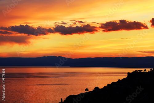 Fotobehang Baksteen Sunset light over Leman Lake, Geneva, Europe