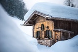old traditional wooden cabin lodge shack in bavarian alps with lots of snow in winter - 199180256
