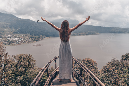 Plexiglas Donkergrijs beautiful girl with long dark hair in elegant grey dress posing in beautiful nature place in Bali