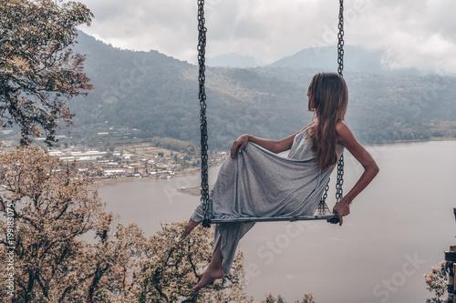Fotobehang Bleke violet beautiful girl with long dark hair in elegant grey dress posing in beautiful nature place in Bali