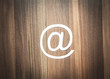 Paper email symbol on the wood background.