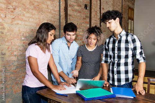 Group of young people planning strategy in modern office