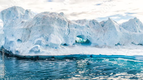 Climate Change and Global Warming - Icebergs from melting glacier in icefjord in Ilulissat, Greenland. Aerial video of arctic nature ice landscape. Unesco World Heritage Site.