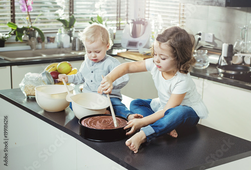 Fotobehang Artist KB Cheerful siblings making a dessert