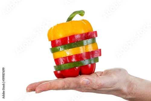 A selection of colorful sweet peppers sliced in pieces to make one pepper on hand - 199187699