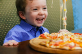 Child, boy, eating pizza at a restaurant, , summertime - 199189619