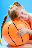 Cute little girl with the big inflatable beach ball