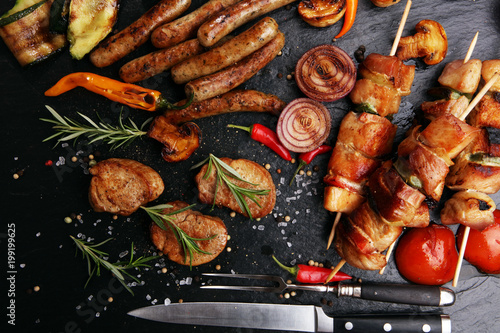 Assorted delicious grilled meat with vegetable on a barbecue - 199199625