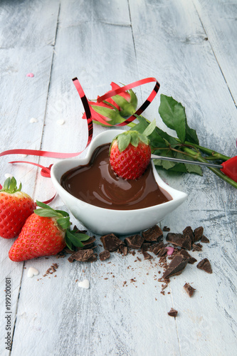 Valentine Chocolate fondue melted with fresh strawberries and dark chocolate and roses - 199200081