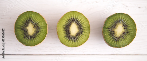 Sliced Kiwi Fruit on a White Wood Table in a Bright Kitchen - 199202627