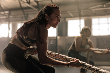 Women exercising with rope at a gym