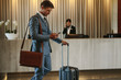 Business traveler arriving at his hotel - 199205884