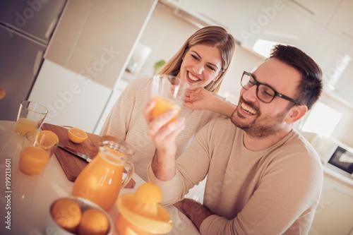 Fotobehang Sap Couple drinking orange juice at home