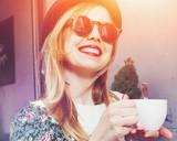 cheerful girl drinking coffee in morning sunlight - 199216699