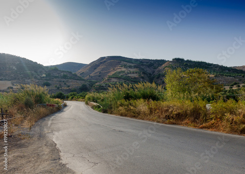 Fotobehang Bleke violet Road leading towards mountain, Crete, Greece