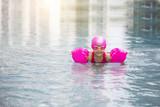 happy asian girl love swimming pool.