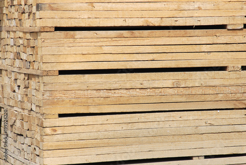 close up on stacking wood at construction site - 199226220