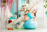 Pregnant woman during workout - 199231875