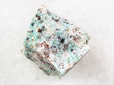 rough amazonite granite stone on white
