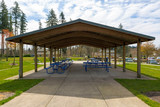 Picnic Tables under Shelter in Suburban City Park