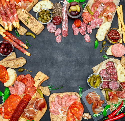 Italian meat appetizer snack set. Salami, prosciutto, bread, olives, capers - 199245415