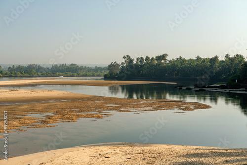 Foto Murales Tropical sunrise over winding river