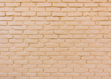 Beige painted brick wall background
